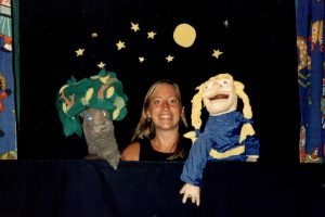 Puppeteer Nina with large hand-puppets