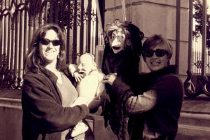Puppeteers with baby and witch puppets